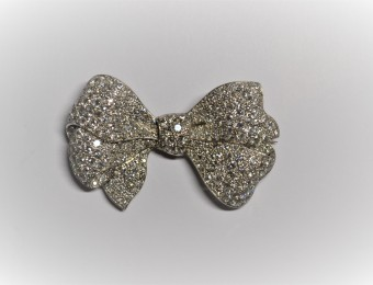 A diamond bow brooch.  Mid 20th Century